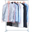 Stock Photo: Office male shirts in cases for storing on hangers, isolated on white
