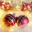 Christmas ornaments and garland on bright background close-up — Stock Photo #36125193