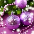 Christmas balls on fir tree, on color background — Stock fotografie