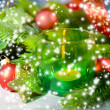 Composition with Christmas balls, candle and decorations on fir tree, close up — Stock Photo #36127171