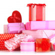 Pile of colorful gifts boxes isolated on white — Stock Photo