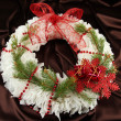 Christmas wreath on fabric background — Foto de Stock