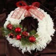 Christmas wreath on fabric background — Stock Photo