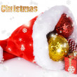 Christmas hat with Christmas decorations isolated on white — 图库照片