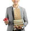 Young teacher with books and apple isolated on white — Stock Photo #36128395