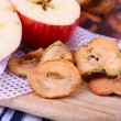 Dried apples in glass jar, on color wooden background — Стоковая фотография