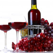 Wineglasses with red wine, grape and bottle isolated on white — Stock Photo