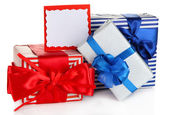 Gift boxes with blank label isolated on white — Stockfoto