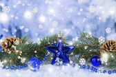 Composition of the Christmas decorations on light winter background — Stock Photo