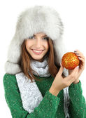 Beautiful smiling girl with Christmas ball isolated on white — Stockfoto