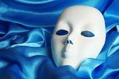 Mask on blue fabric background — Stockfoto