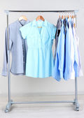Office clothes on hangers, on gray background — Stock Photo