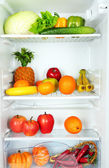 Vegetables and fruits in open refrigerator. Weight loss diet concept. — Stock Photo