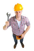 Portrait of young builder isolated on white — ストック写真