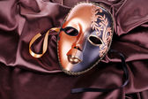 Mask on brown fabric background — Stock Photo