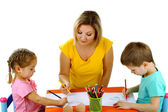 Little children drawing with mom isolated on white — Stock Photo