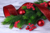 Christmas balls on fir tree, on wooden background — Stock Photo