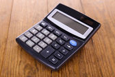 Digital calculator on table close-up — Stockfoto