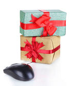 Gifts and computer mouse isolated on white — Стоковое фото