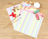 Paper for scrapbooking and tools, on wooden table — Foto Stock