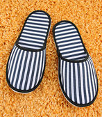 Striped slippers on carpet background — Foto Stock