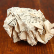 Crumpled paper ball on wooden background — Stock Photo
