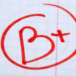 Grade B written on an exam paper — Stock Photo