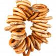 Foto Stock: Tasty bagels on rope, isolated on white
