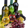 Bottles and glasses of wine and assortment of grapes, isolated on white — Stockfoto