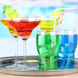 Different  colorful cocktails on bright background — Stok fotoğraf
