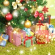 Decorated Christmas tree with gifts close-up — 图库照片