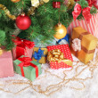 Decorated Christmas tree with gifts close-up — Stock Photo