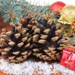Christmas decoration with pine cones on wooden background — Stok fotoğraf #36233561