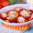 Stuffed tomatoes in bowl on wooden table close-up — Stock Photo