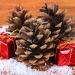 Christmas decoration with pine cones on wooden background — Stok Fotoğraf #36234225