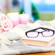 Composition with old book, eye glasses, candles, flowers and plaid — Stock Photo #36234501