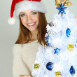 Beautiful smiling girl near Christmas tree close-up — Stock Photo