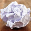 Stock Photo: Crumpled paper ball on wooden background