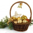 Christmas decorations in basket and spruce branches isolated on white — Stock Photo #36236783
