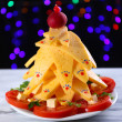 Christmas tree from cheese on table on dark background — Stock Photo
