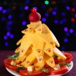 Stock Photo: Christmas tree from cheese on table on dark background