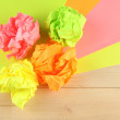 Colorful crumpled paper balls on wooden background — Stock Photo #36236919