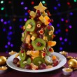 Stock Photo: Fruit Christmas tree on table on dark background