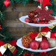 Christmas decorations on dessert stand, on wooden background — Stock fotografie