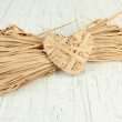 Decorative straw for hand made and heart of straw, on wooden background — Stock Photo #36236989