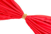 Red cloth tied with beads isolated on white — Stock Photo