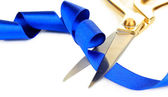 Satin ribbon curled around scissors isolated on white — Stock Photo