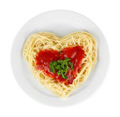 Cooked spaghetti carefully arranged in heart shape and topped with tomato sauce, isolated on white — Stock Photo