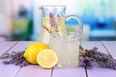 Lavender lemonade, on violet wooden table, on bright background — Stock Photo