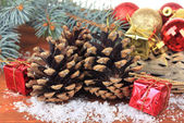 Christmas decoration with pine cones on wooden background — Stok fotoğraf